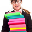 Schoolgirl carrying color stack books — Stock Photo #5304824