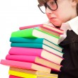 Unhappy school girl with stack color books — Stock Photo #5304834