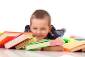 Preschooler with pile of books — Stock Photo
