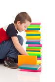 Boy playing with books — Stock Photo