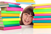 Student behind pile of books — Stock Photo