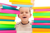 Boy behind pile of books — Stock Photo