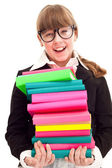 Schoolgirl carrying color stack books — Stock Photo