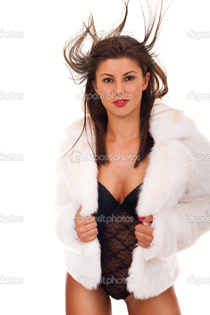Portrait of very sexy woman wearing fashionable winter fur coat - isolated ...