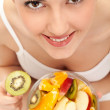 Girl eating fresh fruit salad — Stock Photo