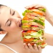 Girl eating sandwich, big bite - Stock Photo