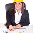 Female architect working on plans — Stock Photo