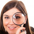 Woman with magnifying glass — Stock Photo #5369342