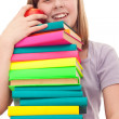 Girl with book stack and apple — Stock Photo #5369379