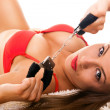 Hot brunette with handcuffs - Stock Photo