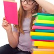 Clever school girl reading — Stock Photo