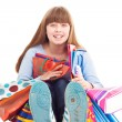 Teen girl holding gift bags — Foto Stock