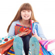 Teen girl holding gift bags — Stock Photo