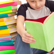 Five year old boy sitting books - Stockfoto
