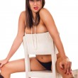Naked brunette girl sits on chair — Stock Photo #5369511