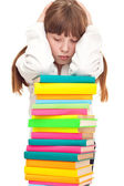 Upset schoolgirl with books — Stock Photo