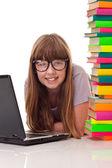 Chica piso con libros y portátil — Foto de Stock