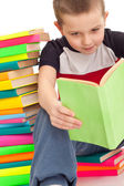 Five year old boy sitting books — Stock Photo