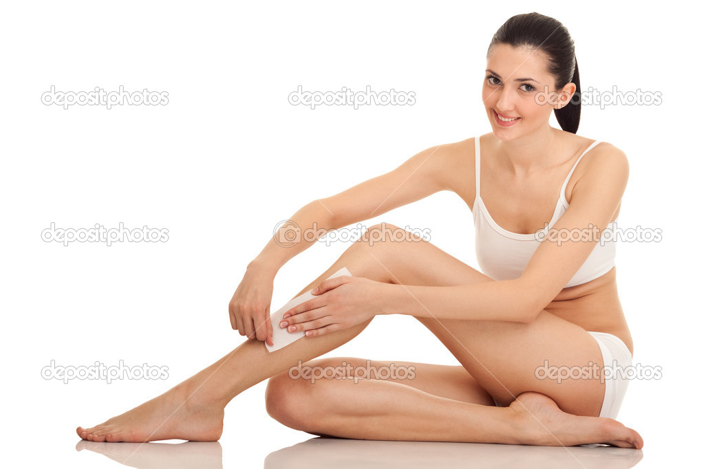 Woman doing depilation on her legs with waxing, isolated on white  — Stock Photo #5369129