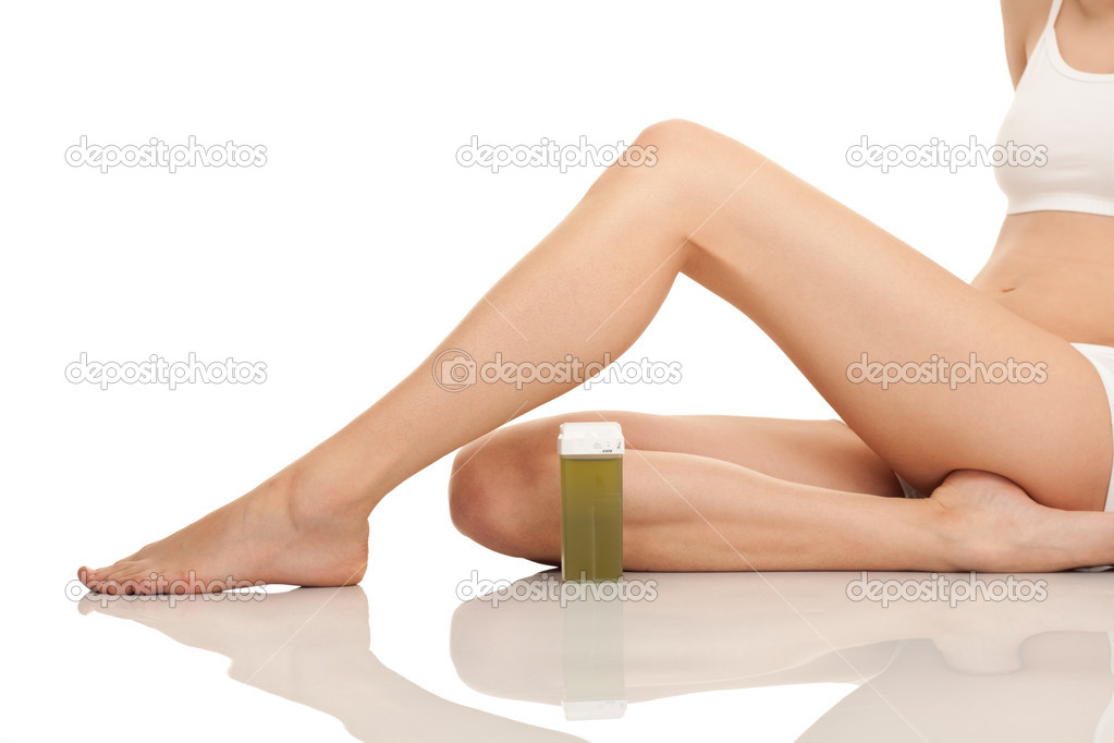 depilating females legs, close up, isolated on white — Stock Photo #5369145