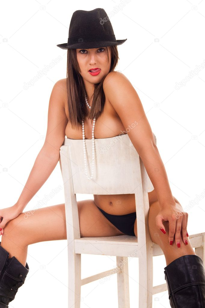 Naked Brute Girl Sits On Chair Stock Image
