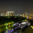 Singapore Night Skyline from Marina Barrage - Stock Photo