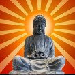 Sitting Full Body Bronze Buddha with Sun Rays — Stock Photo #5356364