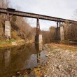 Old railroad bridge over a creek — Stock Photo