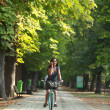 Woman on the phone riding bicycle — Stock Photo