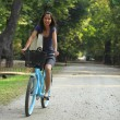 Woman Riding A Bicycle — Stock Photo #3942289