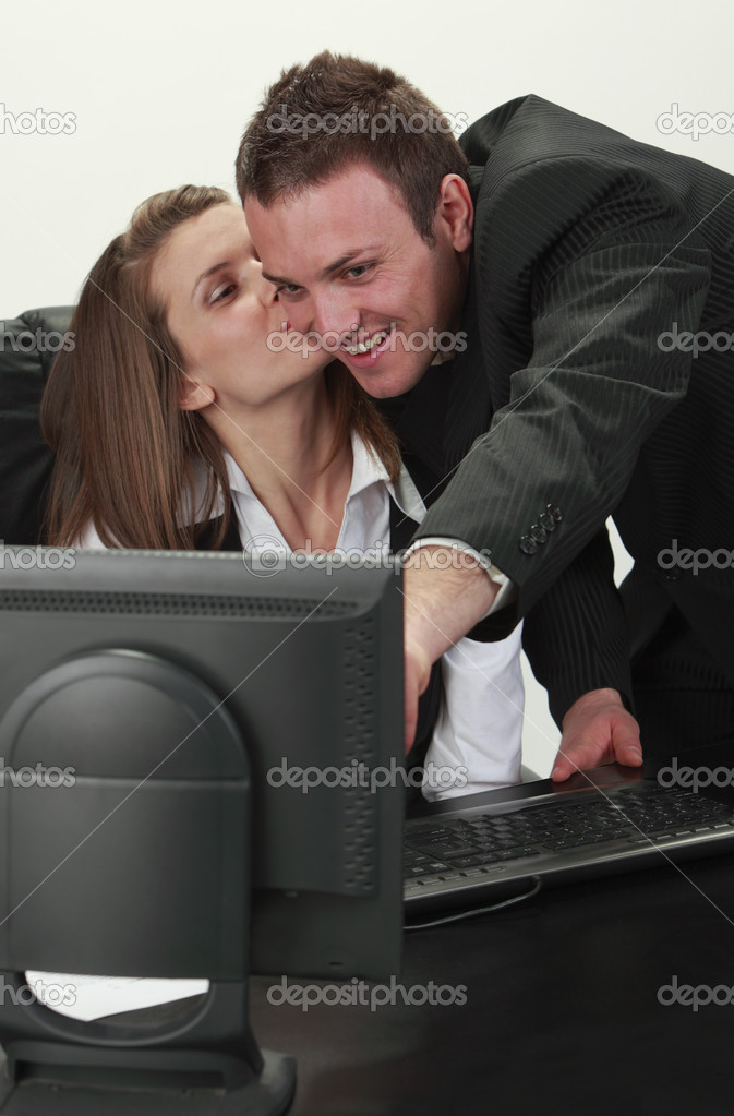 Young office colleagues having fun in front of an office computer. — Stock Photo #3942558