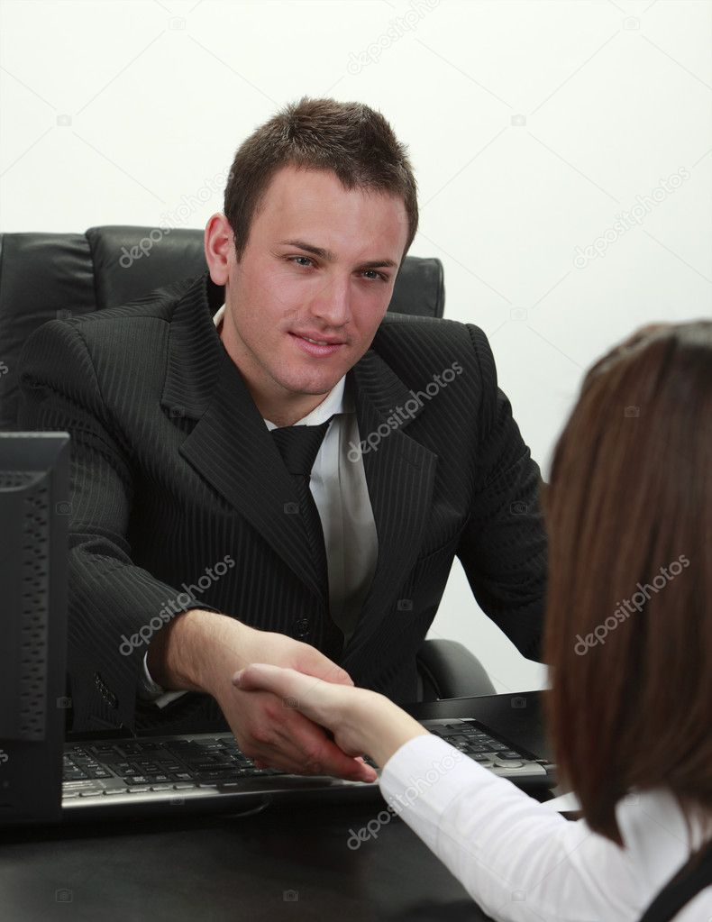 Businessman and businesswoman shaking hands in the office. — Stock Photo #3942657