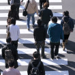 Stock Photo: Group of crossing the street
