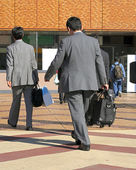 Businessmen travelling — Stock Photo