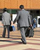Businessmen travelling — Stock Photo