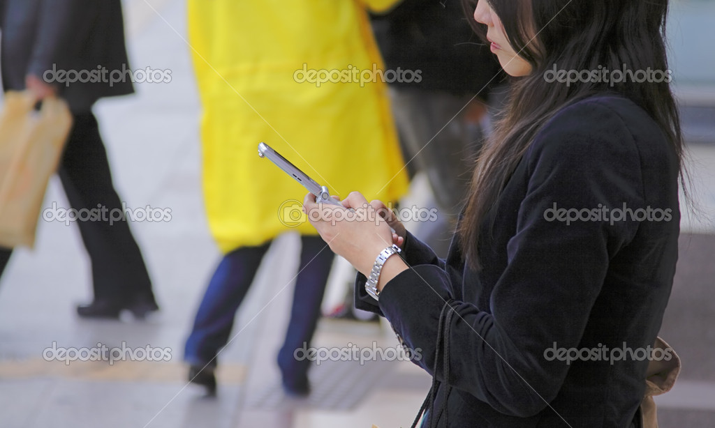 Woman using a cell phone in a street-ldeatil of the hands  Stock Photo #5294162