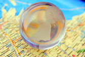 Glass sphere and maps — Stock Photo