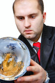 Earth and businessmen — Stock Photo