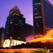 Nightscape downtown fuzhou with blurred bus trailing - Stockfoto