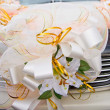 Decorative lilies an ornament of the wedding car — Stock Photo