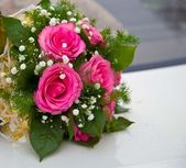 Wedding Bouquet of the bride from pink roses — Stock Photo