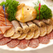 Dish with sausage delicacies — Stock Photo