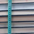 Stock Photo: Structure of book pages and centimetric tape