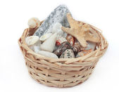 Cockleshells in a basket from straw — Stock Photo