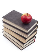 The apple lies on a pile of books — Stock Photo