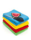Fabric of different colors with a needle case and scissors — Stock Photo