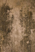 Aged black and grey plaster wall — Stock Photo