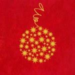 pallina di Natale di fiocchi di neve d'oro su sfondo rosso — Foto Stock