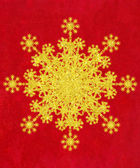 Glitery Gold Snowflake on Creased Background — Stock Photo