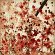Red blossom print on ribbed bamboo background — Stock Photo